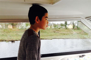Shannon Boat Hire Gallery - Oisin Doran behind the wheel  on the Shannon