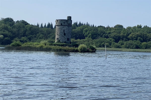 Shannon Boat Hire Gallery - Passing a round tower on Lough Erne