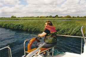 Shannon Boat Hire Gallery - Ines Rudolph fishing from the back of the Lake Star as they make their way downriver.