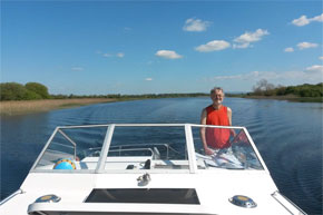 Shannon Boat Hire Gallery - Captain on the bridge!