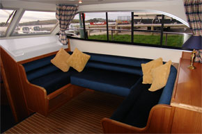Seating area in the saloon of the Manor Chief Hire Boat