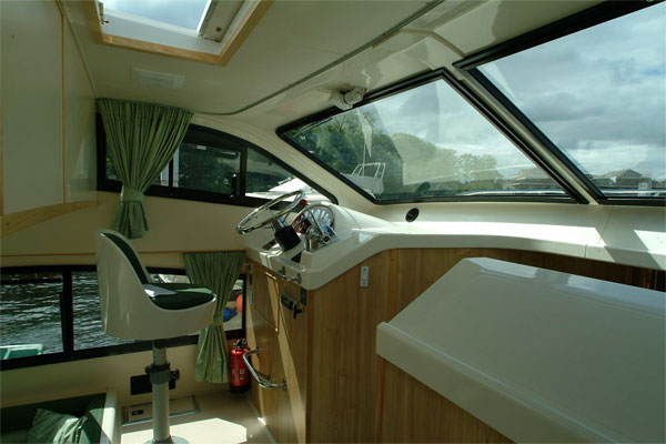 Helm on the Elegance Hire Boat.