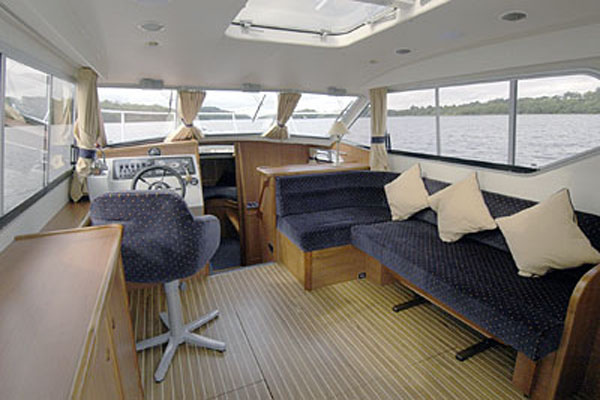 Helm and Saloon on the Inver Prince 2+2 berth hire boat