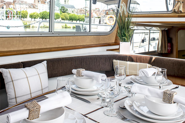 Table set for lunch in the saloon of the P1020 Penichette - hire on Shannon River