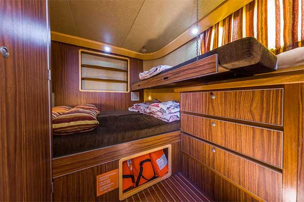 Front cabin with pull-out bed on the P1400 Penichette.