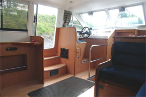 Helm on the Noble Commander hire boat.