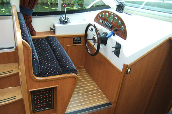 Helm on the Roscommon Class hire boat Ireland.
