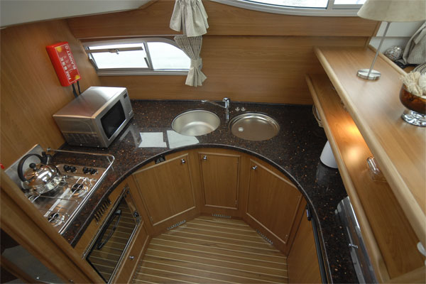 The well-equipped galley on the Silver Spirit Cruiser - Shannon River Cruises Ireland.