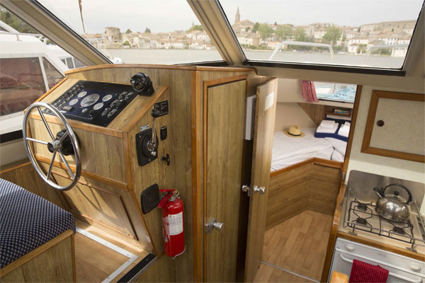 Inside steering and front cabin on the Lake Star cruiser'