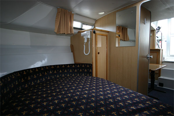 The sleeping cabin on the Tyrone Class Cruiser - Shannon River boat hire Ireland.