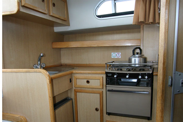 The galley on the Tyrone Class cruiser - Shannon River boat hire Ireland.