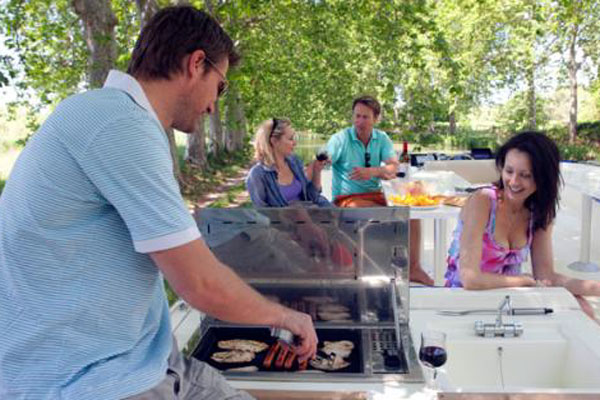 Barbecue on the sundeck of the Vision 4 hire boat.