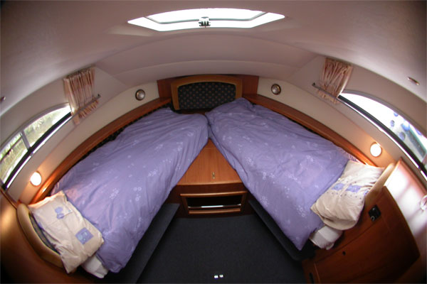 The forward cabin on the Wexford Class cruiser set up as two single beds.