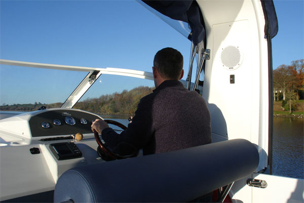 Flybridge steering on the Noble Emperor Hire Cruiser