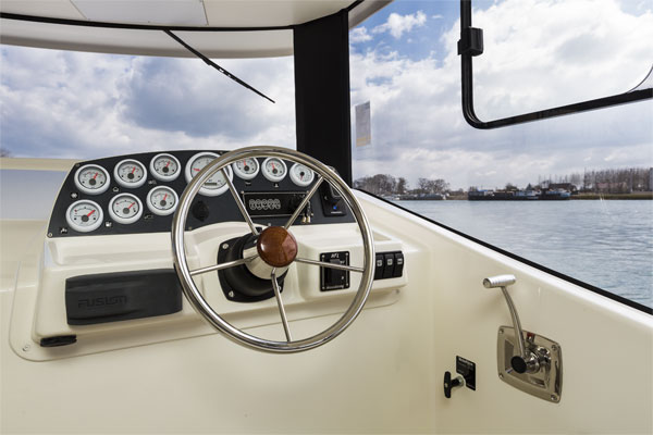 Inside steering position on the Horizon Class Hire Boat.