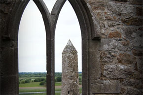 Looking for a window of the monastery at Clonmacnoise
